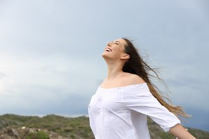 Positive woman breathing enjoying