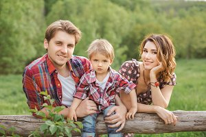Portrait of Happy Family in a Park
