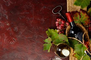 Wine composition on rustic backgroun