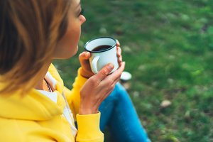 cup of tea in the hands of a girl