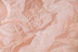 Crumpled peachy paper texture