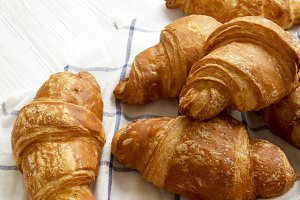 Freshly baked croissants on cloth