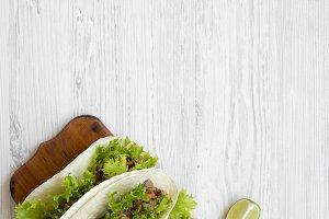 Shrimp tacos on wooden board