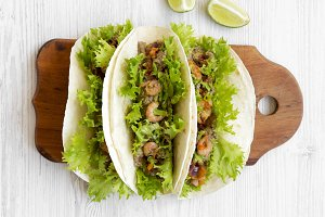 Shrimp tacos on rustic wooden board
