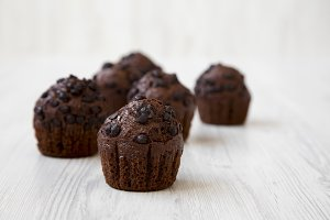 Chocolate cupcakes on white wooden