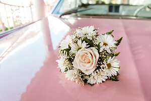 Wedding Bouquet On The Top Of Car