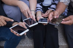 group of people using smart phone fo