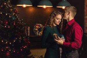 Loving couple celebrates Christmas