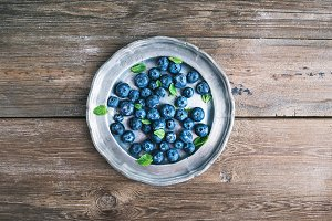 Vintage plate full of blueberries