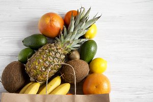 Paper bag of different fresh fruits