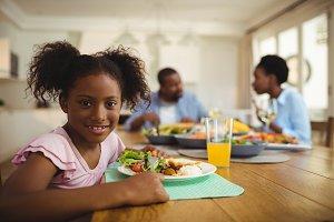 Portrait of girl having meal