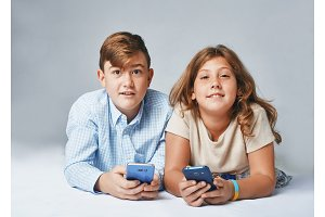 a very happy kids with smartphones