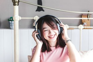 Woman listening music with headphone