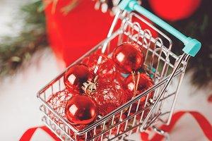 Red Christmas bauble in market baske