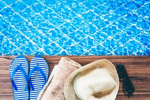 Summer accessories on the swim pool