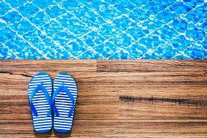 flip-flops on the swimming pool