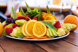 Party plate with fresh fruit cuts on