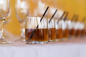Row of whiskey and cognac on a table