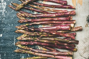Fresh purple asparagus over rustic