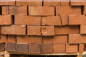 Stack of red brick for construction