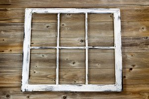 Vintage window on rustic wood