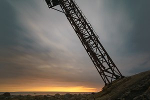 Falling tower against sunrise clouds
