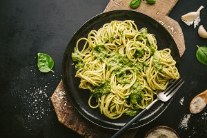 Tasty pasta with pesto served on pla