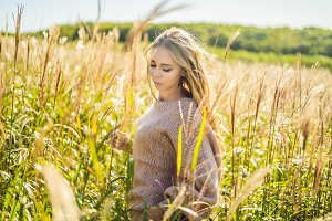 Young beautiful woman in autumn