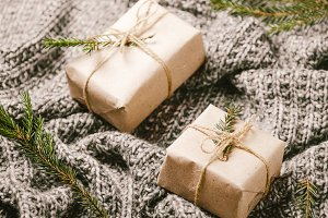 Cristmas gift boxes on a gray plaid.