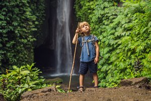 Boy with a trekking stick on the