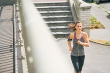 Woman jogger in the zone running alo