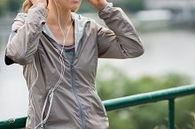 Woman with eyes closed in workout ge
