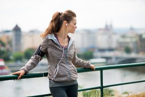 Woman runner with headphones in prof