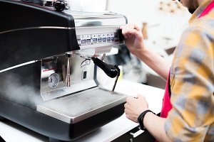 Barista pours coffee from a coffee