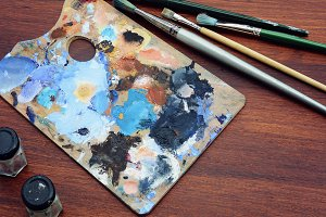 Artist's palette with colorful oil p