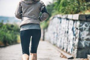 Closeup on fitness young woman joggi