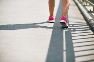 Closeup on fitness young woman walki