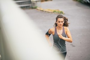 Fitness young woman jogging outdoors