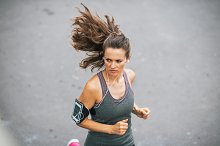 Fitness young woman jogging outdoors by  in Sports