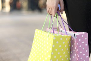 Closeup of woman holding shopping ba