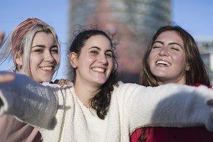 Three happy best girlfriends outdoor