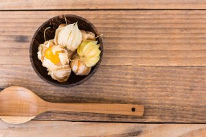 cape gooseberry in wooden bowls