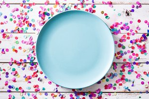 Colorful confetti and blue plate