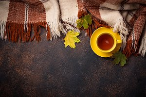 Autumn background with cup of tea