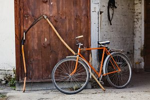 retro bicycle and scythe