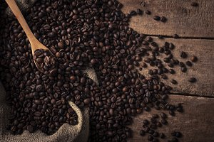 From above coffee beans sack with wo