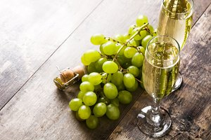 Green grapes and champagne bottle