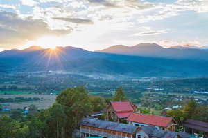 Sunset landscape with mountain villa
