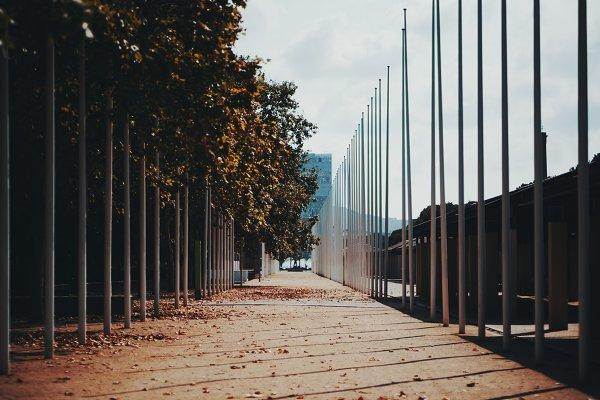 Architecture Stock Photos: SkyNext - Autumn urban street with flagpoles