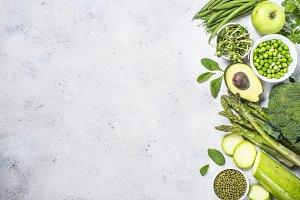 Green food assortment on light stone